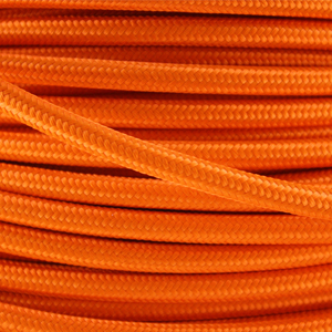 Coloured flex. Fabric lighting cable in an orange finish. Round 3 core flex